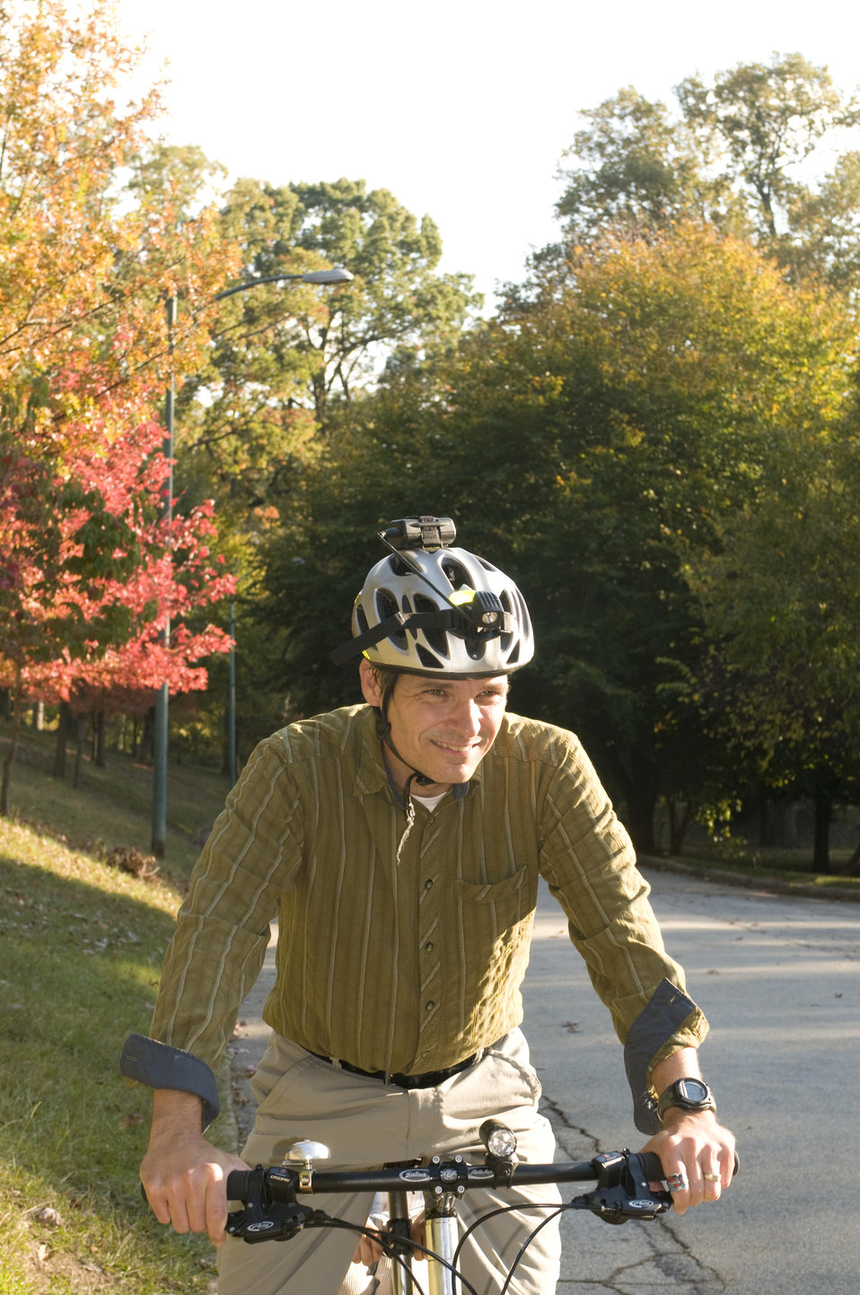 This male bicyclist was spending some time on a beautiful Georgian day, getting some exercise by bicycling on a quite, bike-friendly roadway