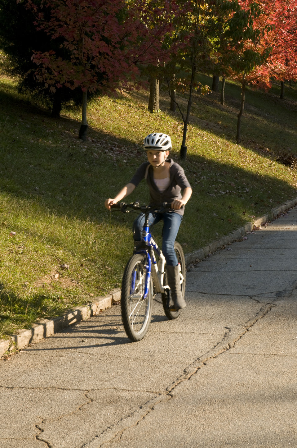This image depicts a young girl who was riding her bicycle on a bright Georgian afternoon. She's been equipped with an aerodynamic safety he