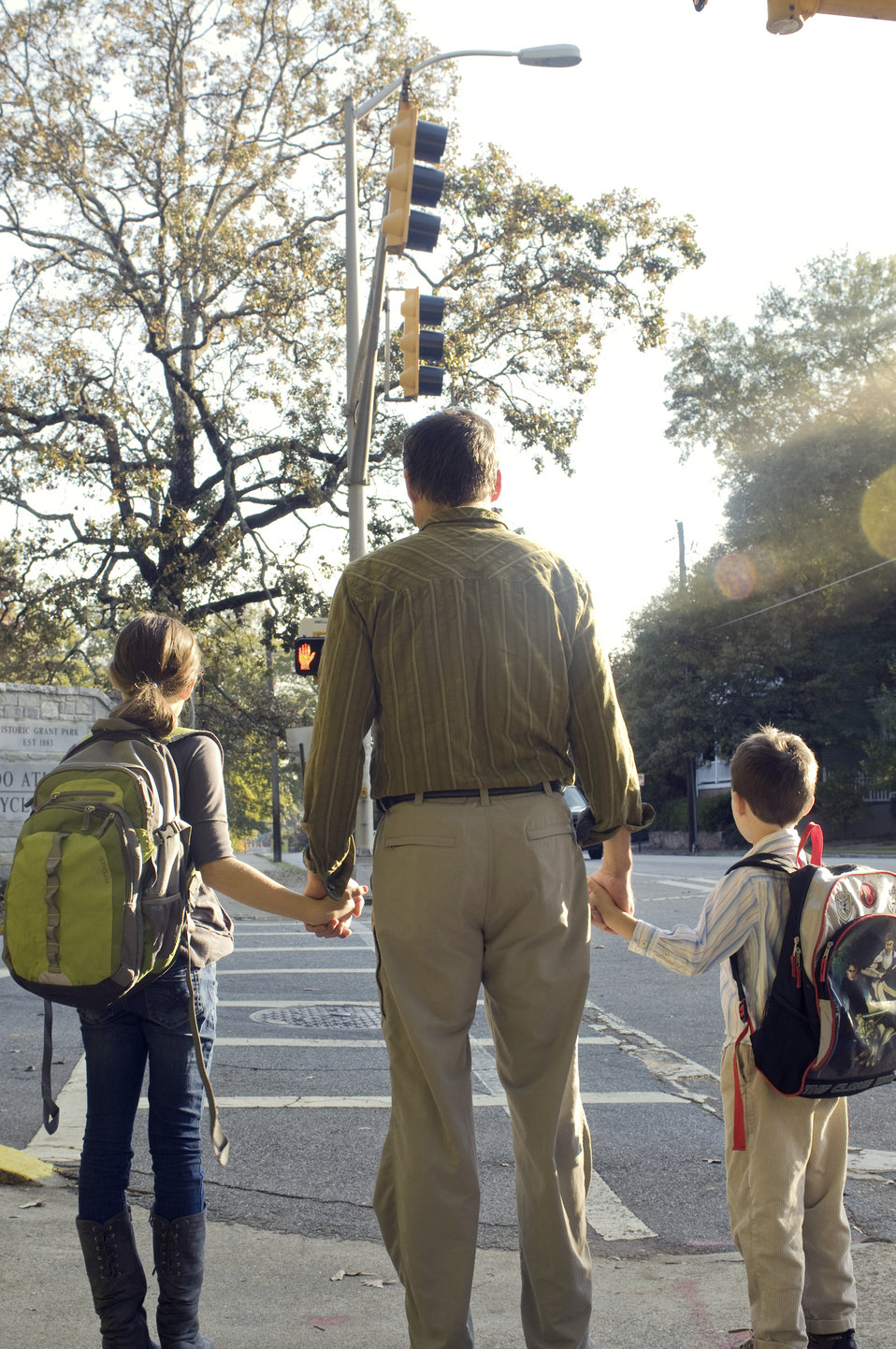 A father walking with his children