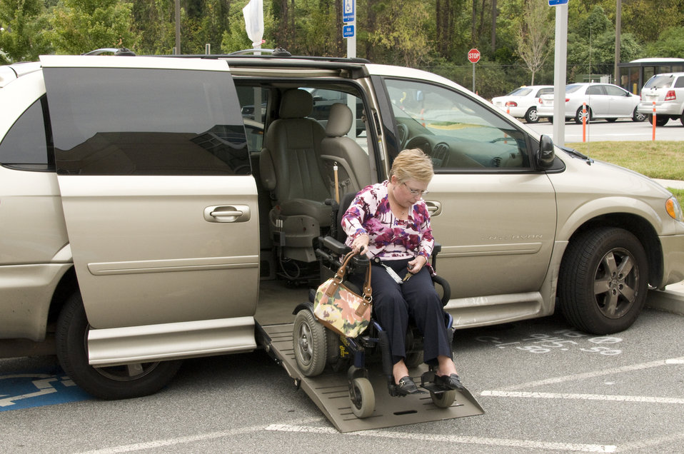 The woman pictured here was seated in her wheelchair, and was proceeding to board her vehicle, which had been outfitted with a ramp, rotatab