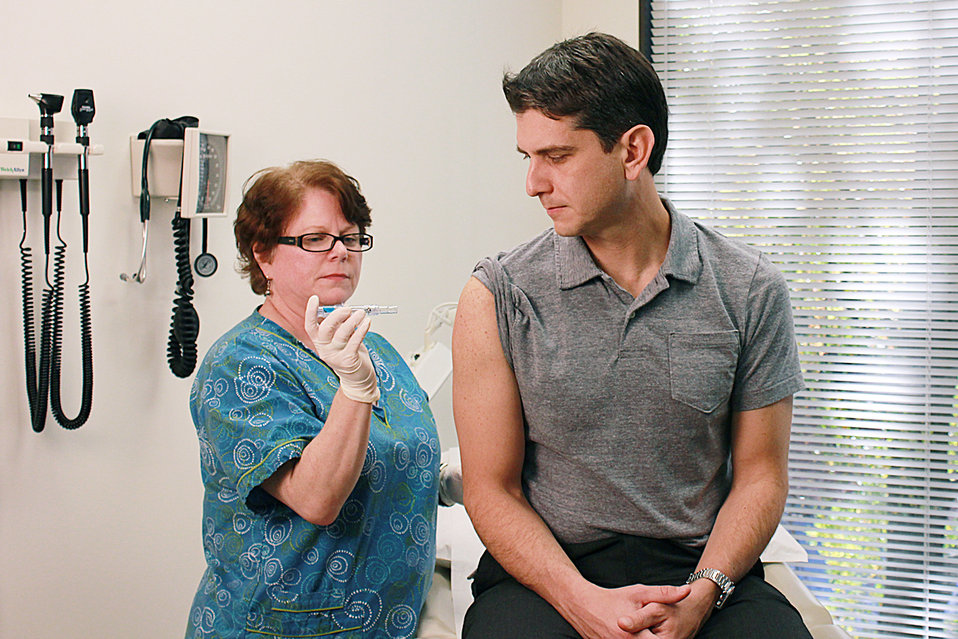 Taken inside a clinical setting, this qualified nurse had just administered a dosage of Fluzone� intradermal influenza virus vaccine to a