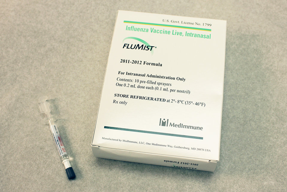 This image depicts a box containing ten prefilled FluMist� live attenuated intranasal vaccine (LAIV) sprayers, along-side of which was a s