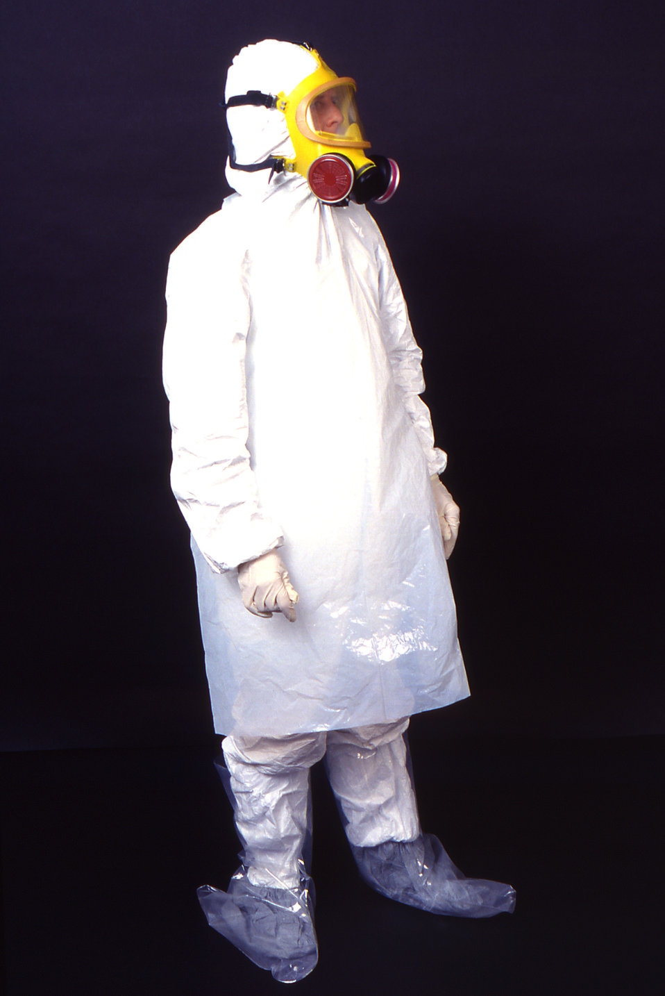 This 1995 image depicts a right anterior-oblique view of a laboratory technician wearing garments usually worn by field techs including a di
