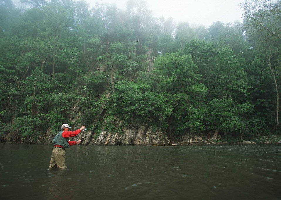 Fly fisherman on the South Fork of the Holston River.  The river is  one of the 10 Heritage rivers in the US.  NRCS worked with local farmer