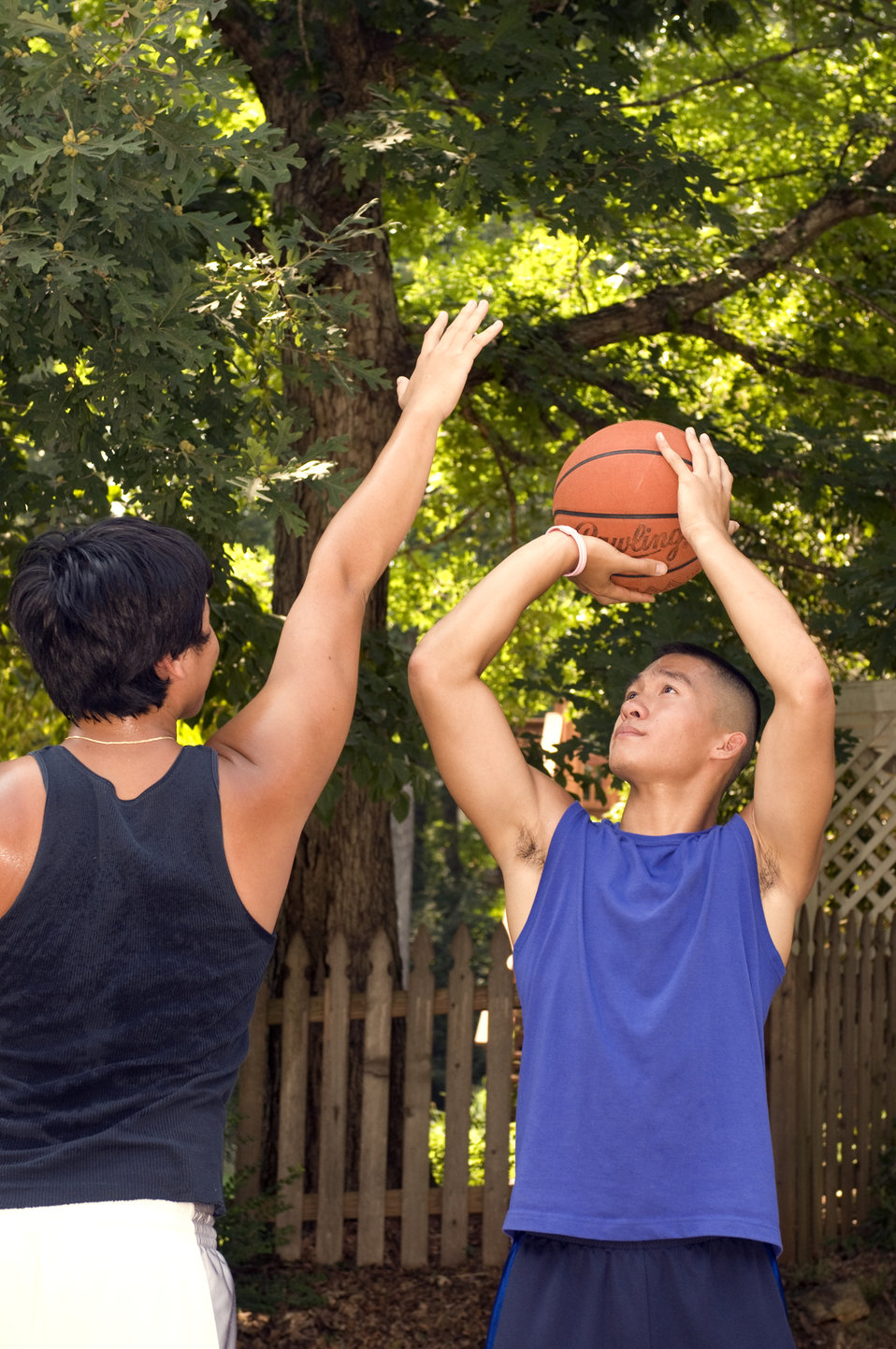These young men were practicing their moves on a basketball court during a casual game on a nice sunny Georgia day.  In this particular view
