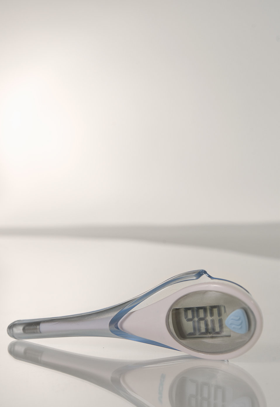 This is a high-tech, orally-administered electronic thermometer revealing its reading on its liquid crystal digital display, which in this c