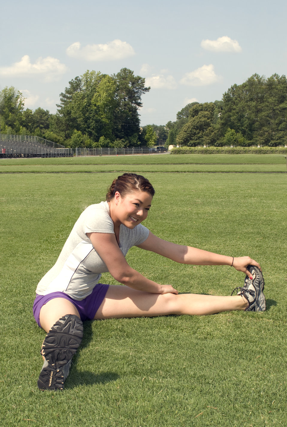 A young woman stretching before exercise