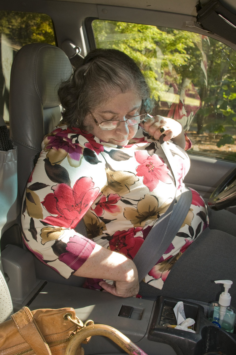 Finally, after having loaded her luggage into her vehicle's back seat area this woman, who is a rheumatoid arthritis patient, had entered th