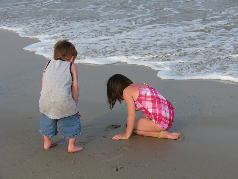 A boy and girl on the beach