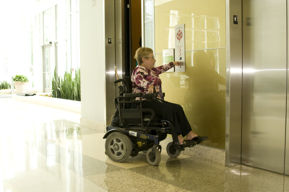 Seated in her wheelchair, the woman pictured here had reached the elevator doors inside a building on one of the Centers for Disease Control