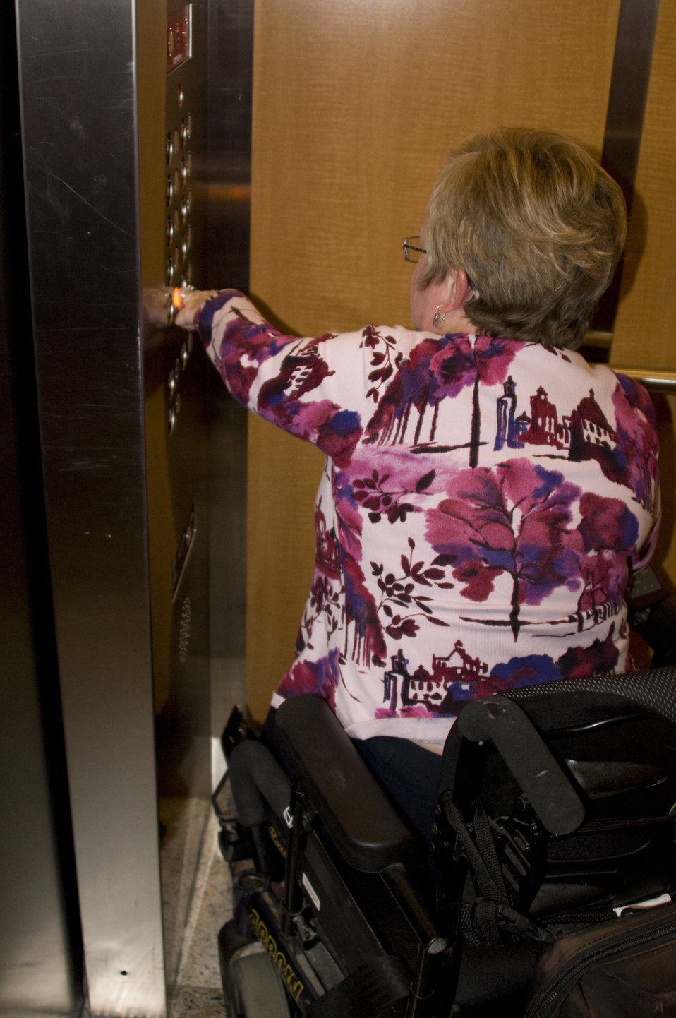 The woman picture here, was seated in her wheelchair, and had boarded an elevator in a highly-accessible building on one of the Centers for