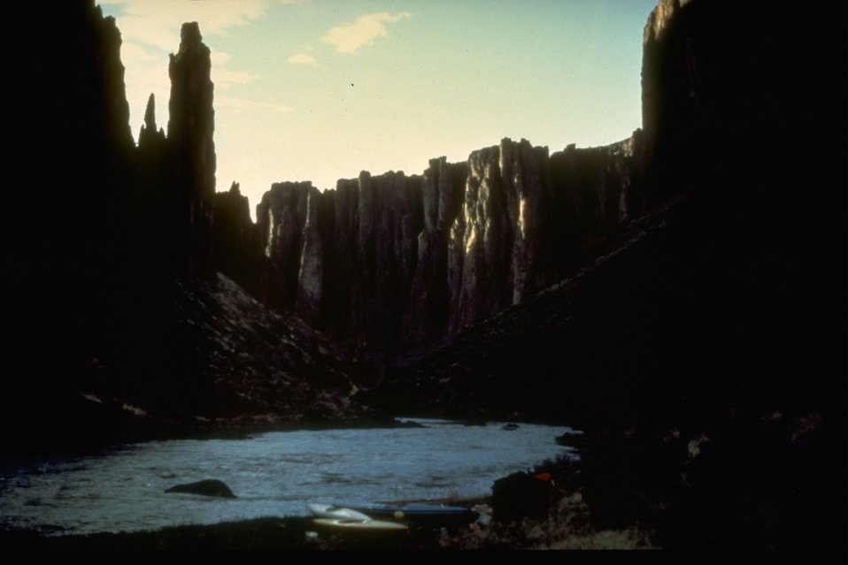 The large cliffs and rock formations surrounding the Owyhee River in the Owyhee River Canyon.