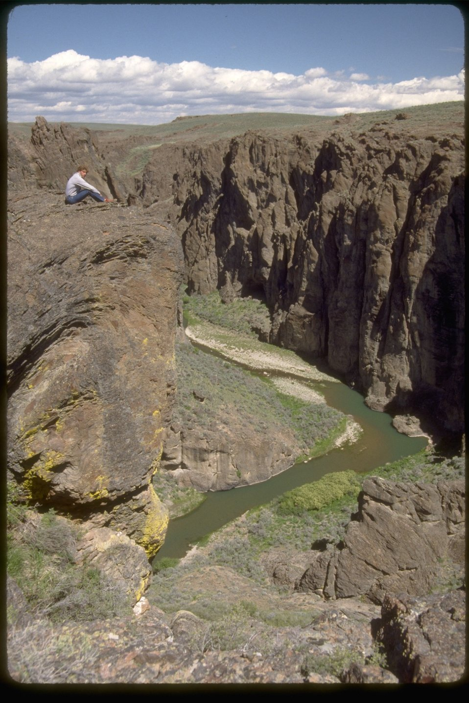 Upper West Little Owyhee from rim with a person sight seeing from the rim.  OR 3-173