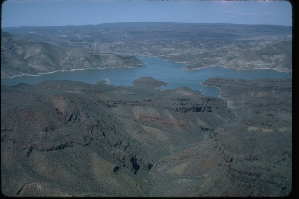 Aerial shot of Owyhee Reservoir in the background.  OR 3-77A