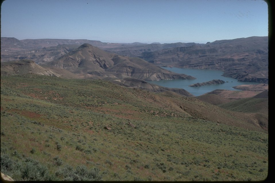 Aerial view of the Dry Creek Buttes with a reservoir in the background.  OR 3-56