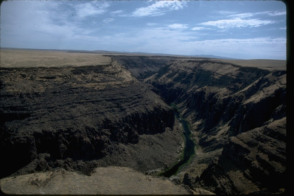 Rim rock view of the steep canyon of Lower Owyhee and river below the Owyhee.  OR 3-110