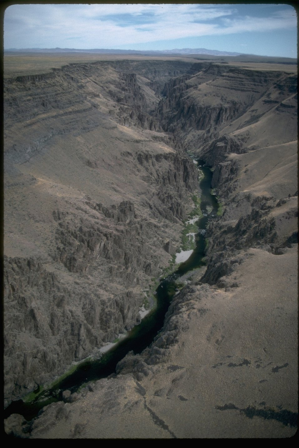 An aerial view of the Owyhee River running through the Owyhee Canyon.  OR 3-195