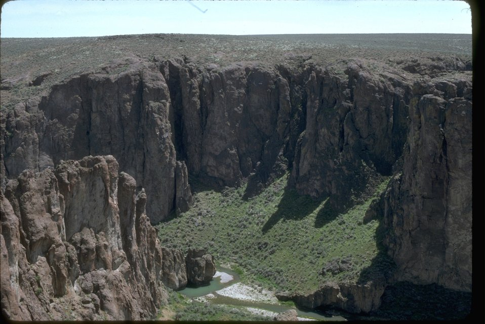 Rim view of Upper Little West Owyhee Canyon and River below.  OR 3-173