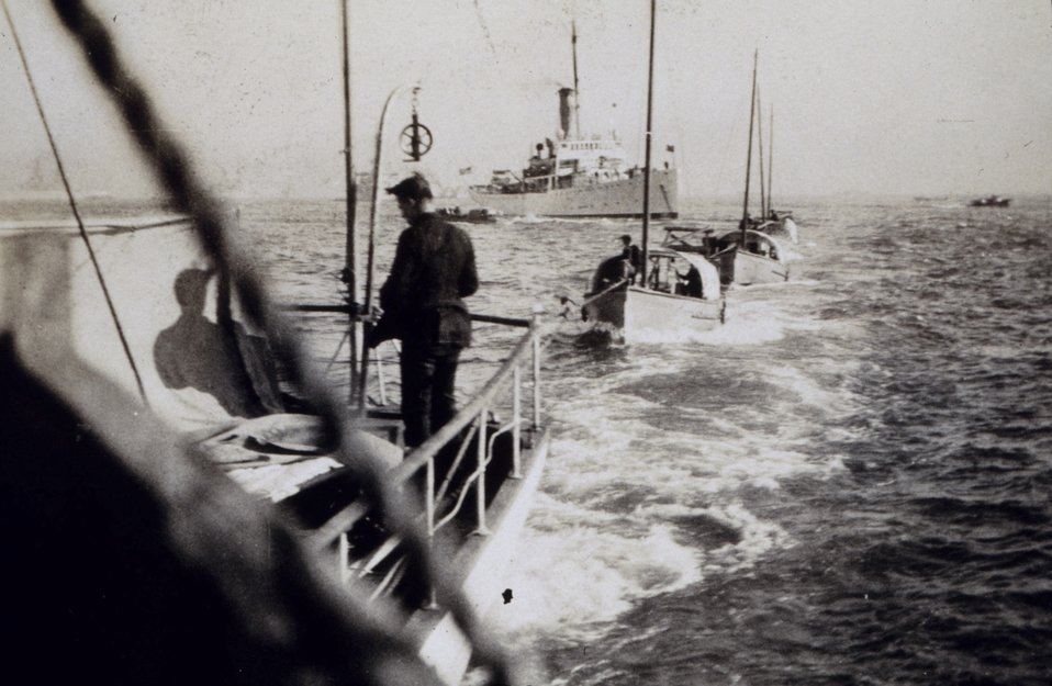 Towing current observation boats to stations - NATOMA in background.