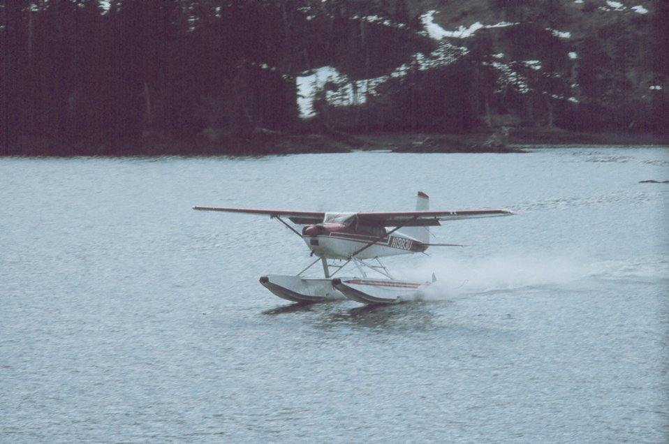 Float plane delivering parts for a heater