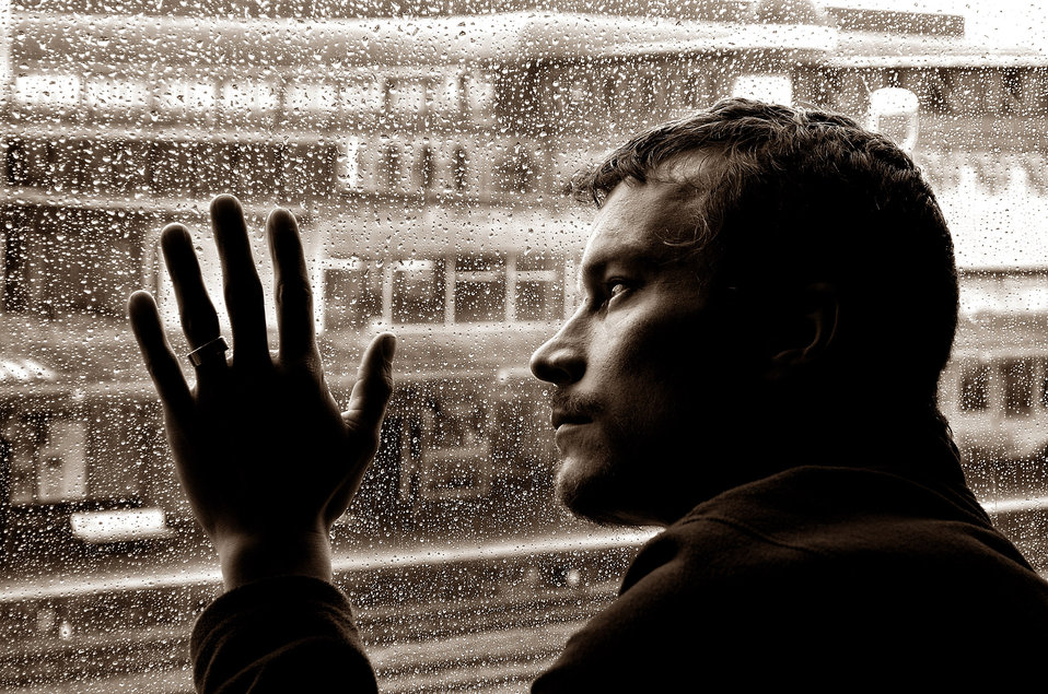 Sad man and rain