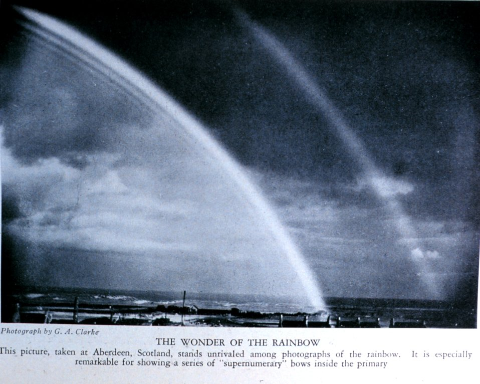 'The Wonder of the Rainbow.'  This picture, taken at Aberdeen, Scotland, stands unrivaled among photographs of the rainbow.  It is especially remarkable for showing a series of 'supernumerary' bows inside the primary. In: 'A Book about the Weather'