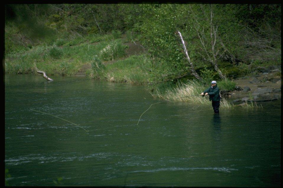 Man fishing in Swiftwater stream.