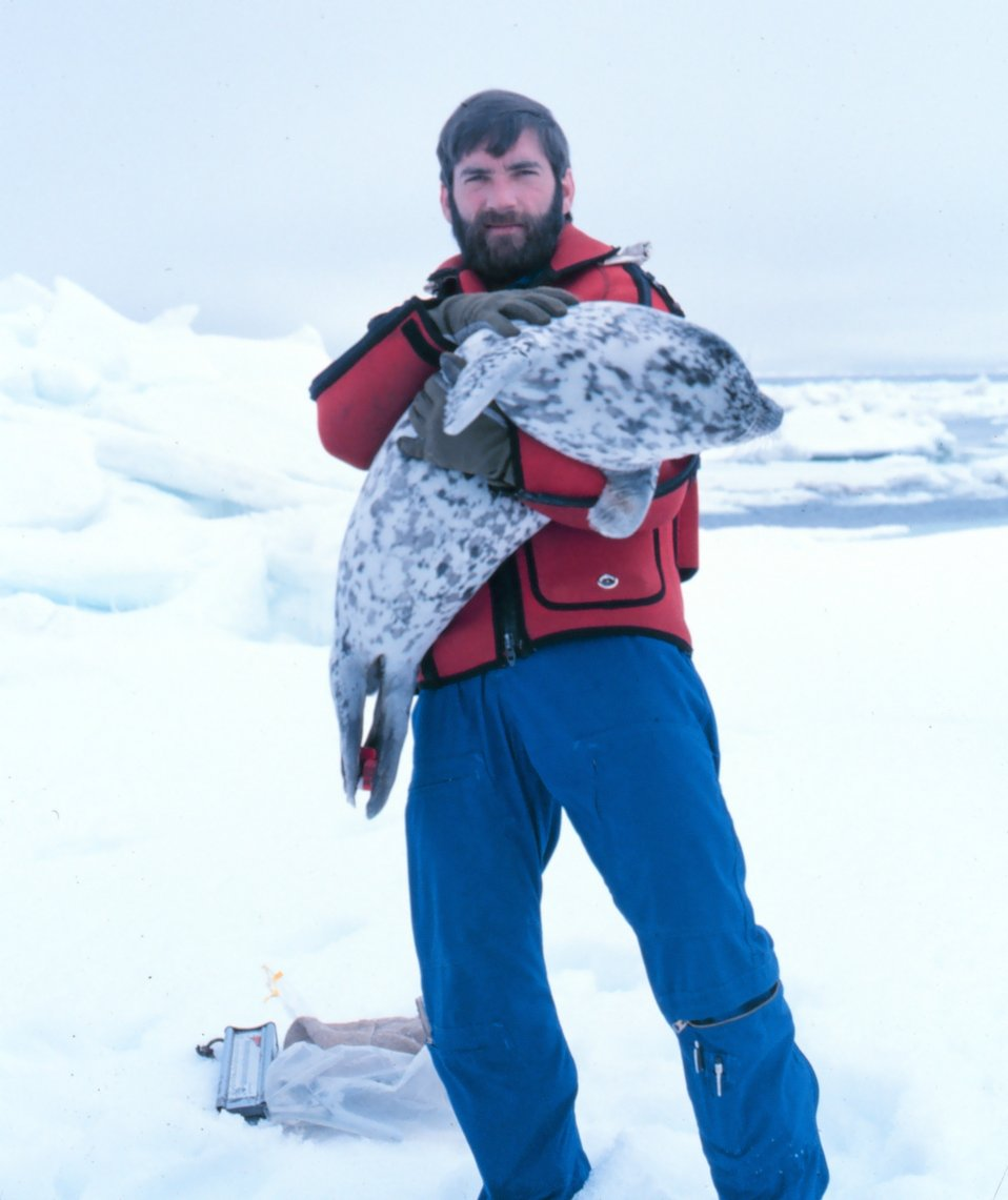 Budd Christman and a new friend - spotted seal - Phoca largha.