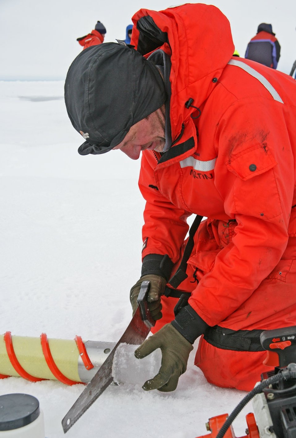 Sawing through ice core to obtain samples for analysis. See: http://www.naturalsciences.org/education/arctic/