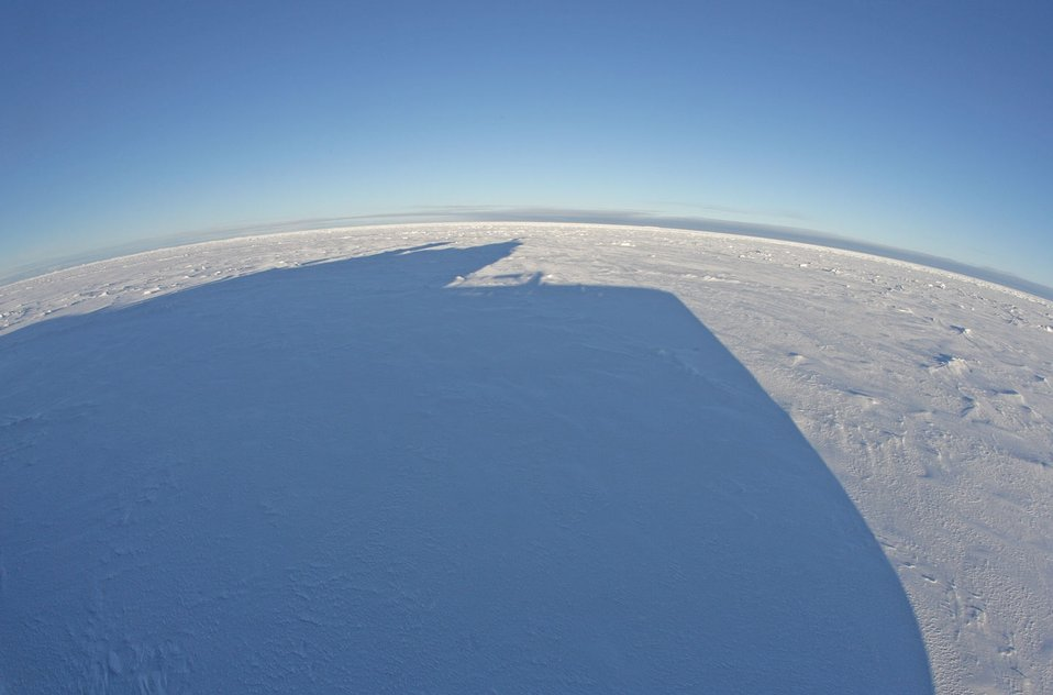 Shadow of the pilot house of the KAPITAN DRANITSYN on the ice. See: http://www.naturalsciences.org/education/arctic/