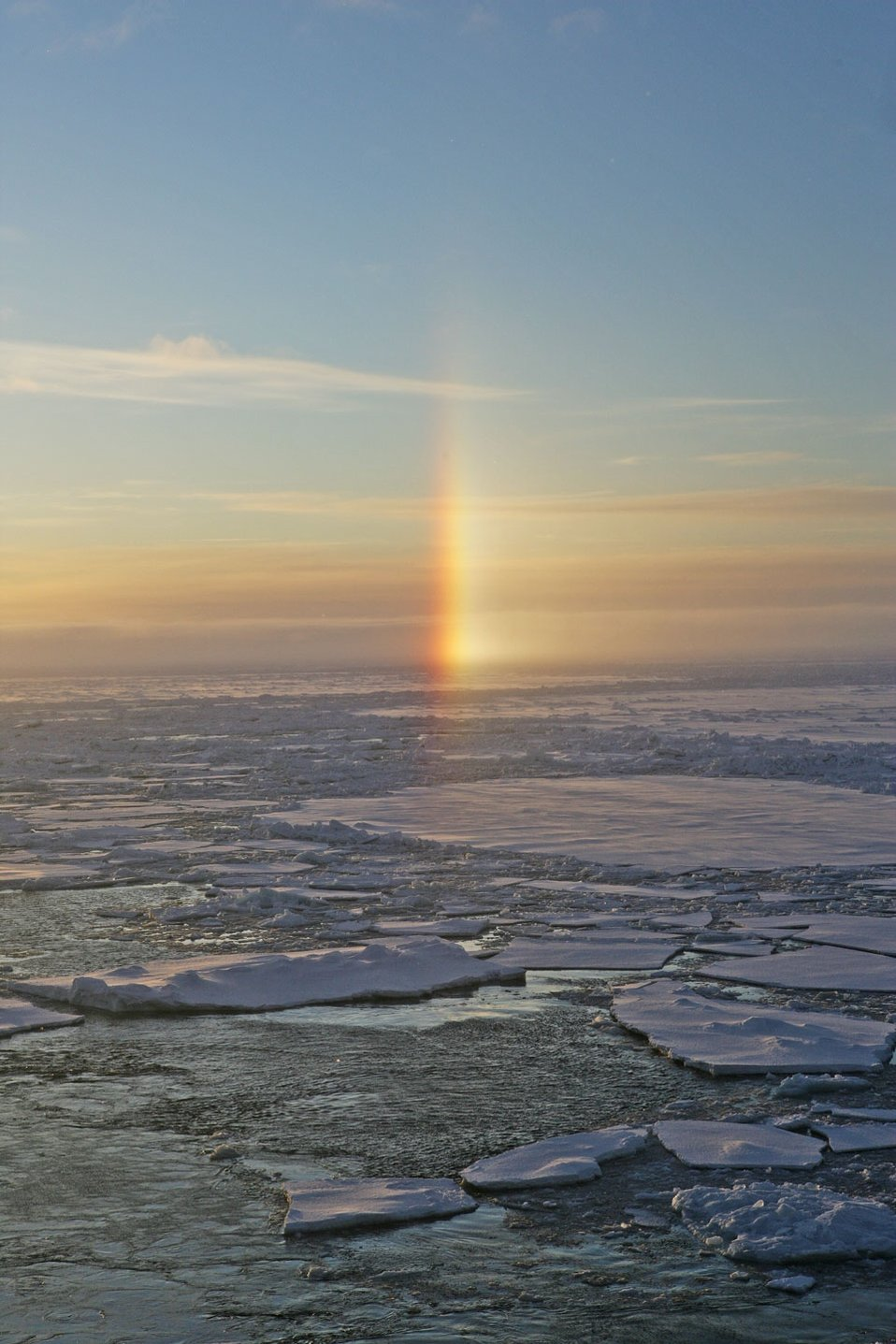 A sun dog - an atmosphere phenomenom caused by refraction of sunlight through ice crystals in the atmosphere.  See: http://www.naturalsciences.org/education/arctic/