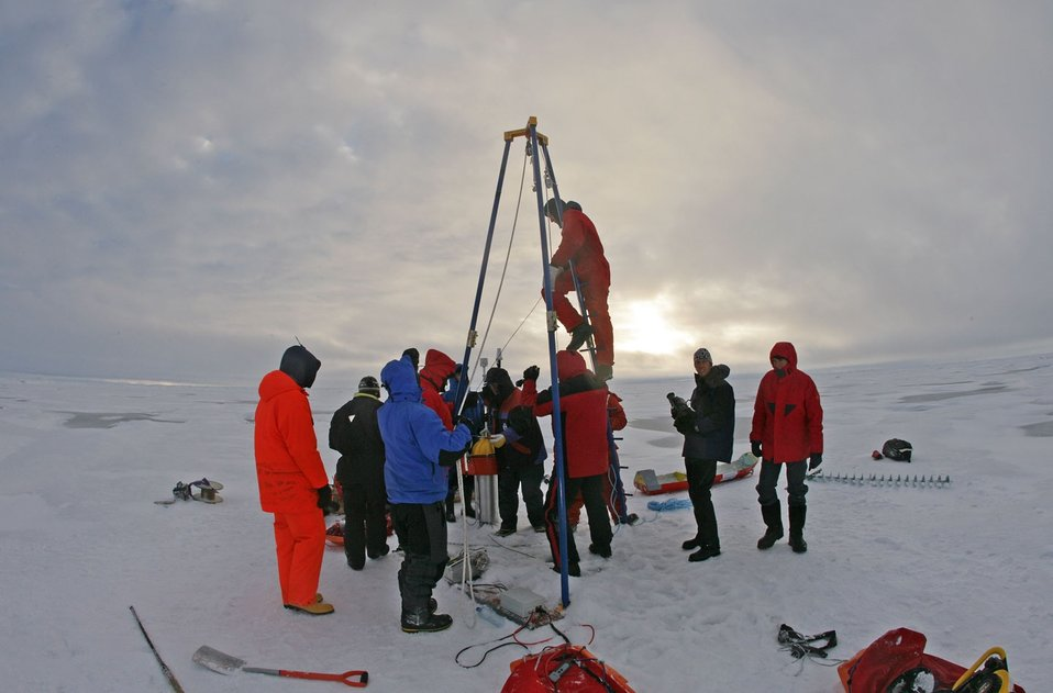 Science team deploying DAMOCLES (Developing Arctic Modeling and Observing  Capabilities for Long-term Environmental Studies) system through ice. See: http://www.naturalsciences.org/education/arctic/
