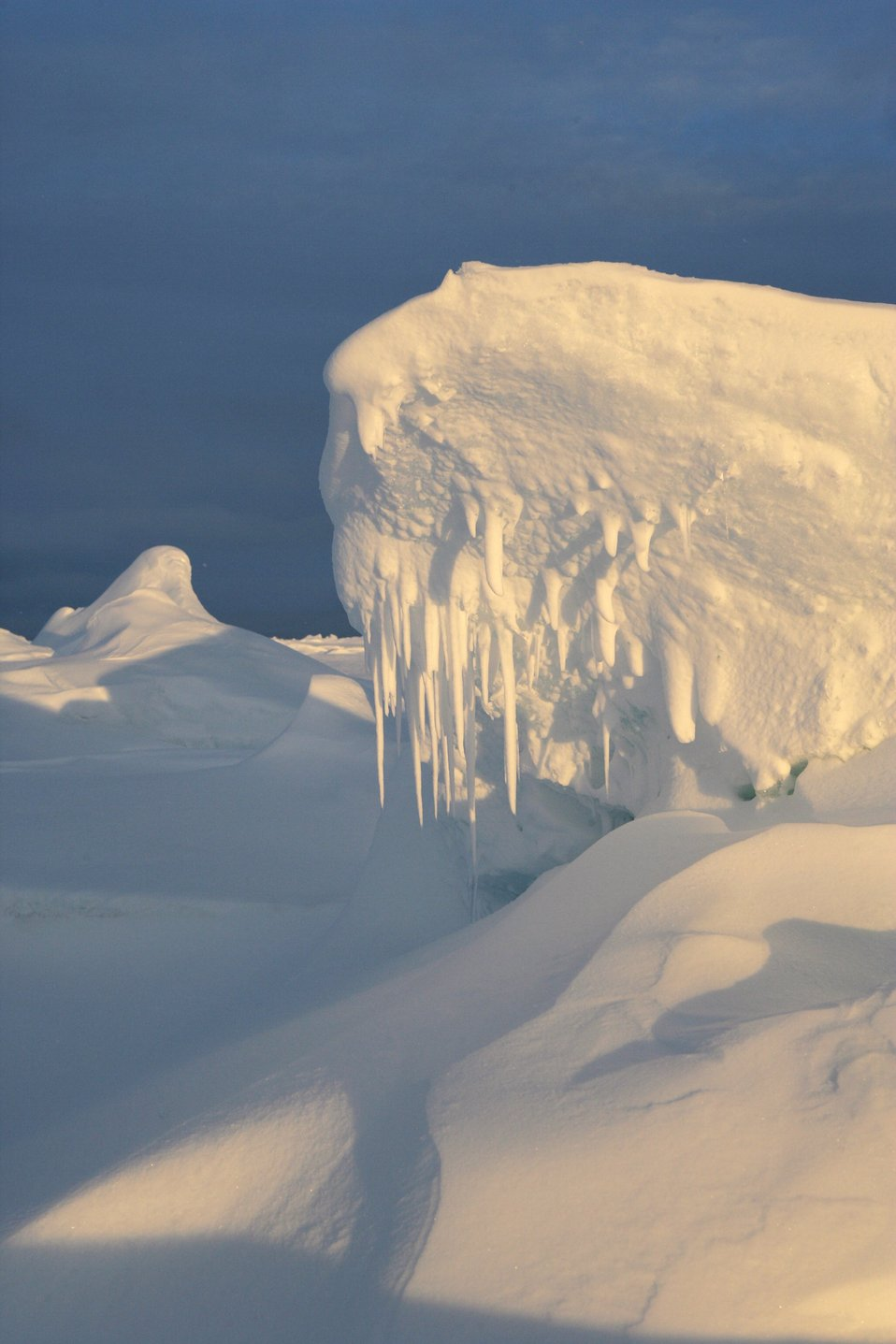 A ridge caused by floes coming together. See: http://www.naturalsciences.org/education/arctic/