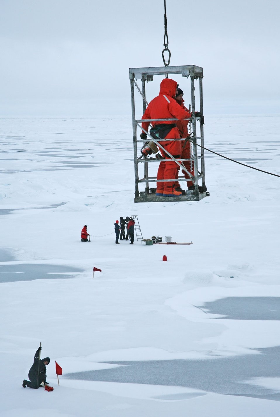 With no gangway available, scientists and crew had to be hoisted from the ship to the ice. NABOS 2006. See: http://www.naturalsciences.org/education/arctic/