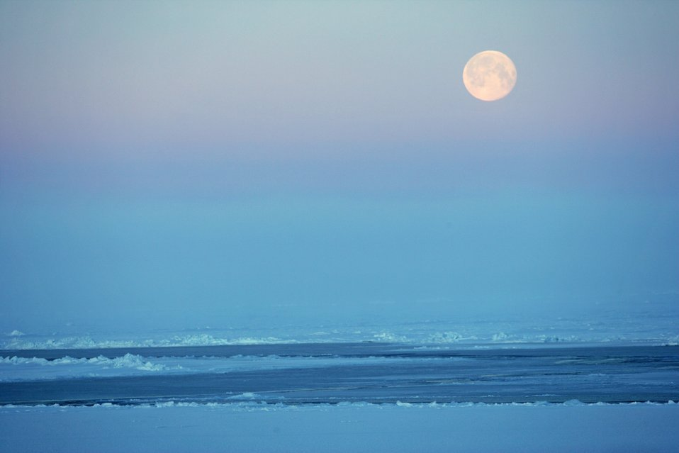 A full moon over Arctic ice. See: http://www.naturalsciences.org/education/arctic/