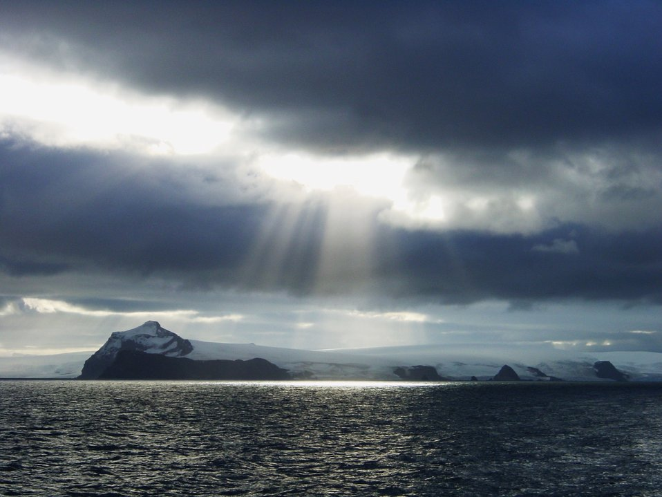 Crepuscular rays illuminating Antarctic Peninsula