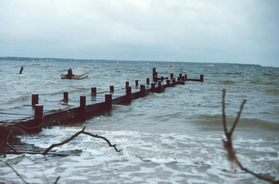 High tide and storm threaten a pier and beach along the Patuxent River.