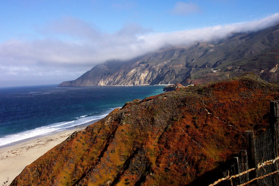 Looking north along the Big Sur coastline with fog-shrouded peaks.