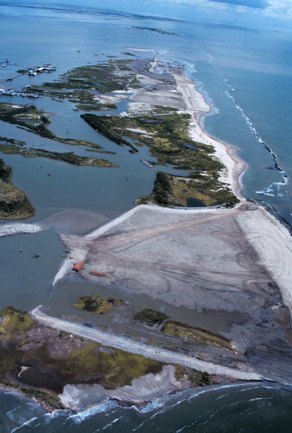 An aerial view of East Timbalier Island, the Gulf of Mexico is on the right. The sandy brown areas in the middle of the photograph are the newly created marsh and dune habitat.