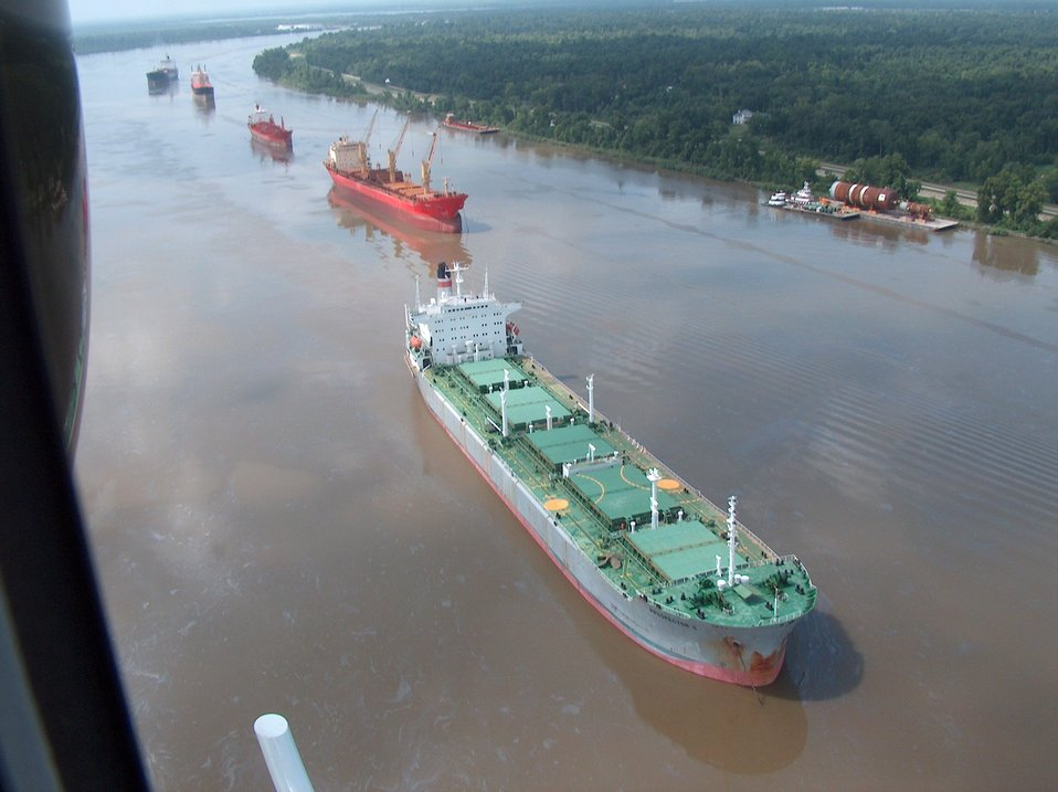A few of the 70 or so vessels waiting to transit the Mississippi River following  the collision of a fuel barge and a chemical tanker resulting in the spill of 419000 gallons of oil.  Over 85 miles of the river was closed to traffic during the incident.