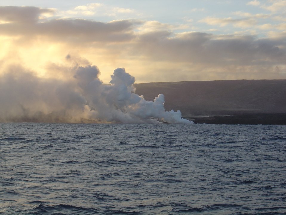 Lava flow entering the sea on SE coast of Hawaii.