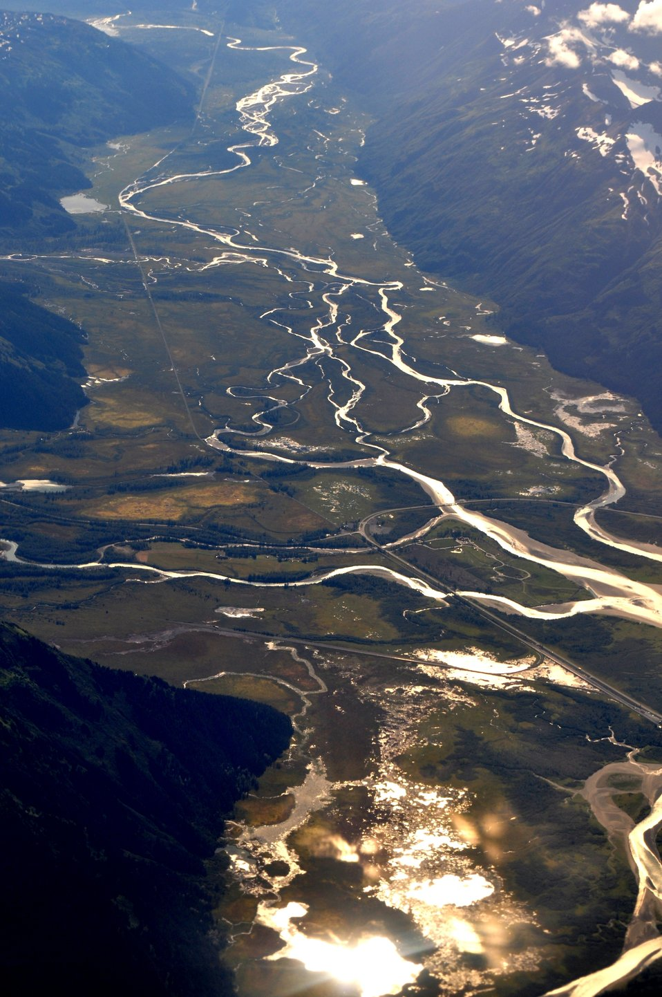 Junction of Portage Glacier Road and Seward Highway.  Bridges cross over Placer River.  Shiny area at bottom of photo is east end of Turnagain Inlet.