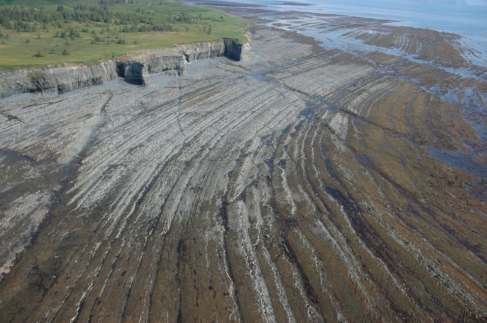 Aerial photograph. A remarkable display of differential erosion in folded strata  at  Contact Point.  Contact Point was named by the United States Geological Survey because of the fault contact between two geological formations at this location.