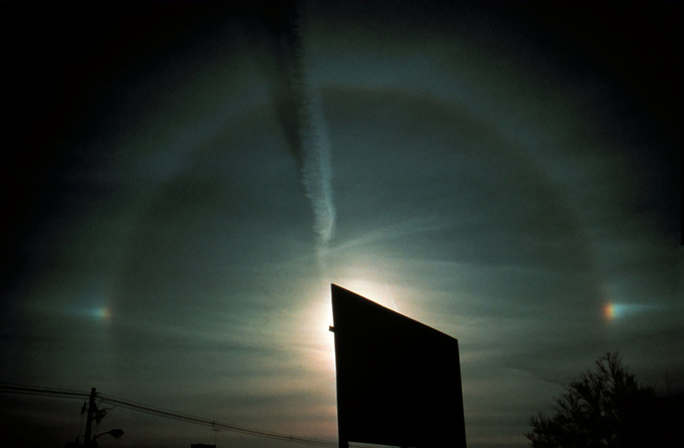 Partial halo with parhelia (sun dogs) on both sides of halo