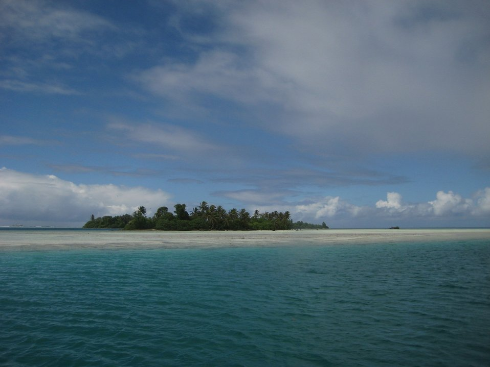 Looking over the reef to Palmyra Island.  The NOAA ship Hi' ialakai is offshore in the left of the image.