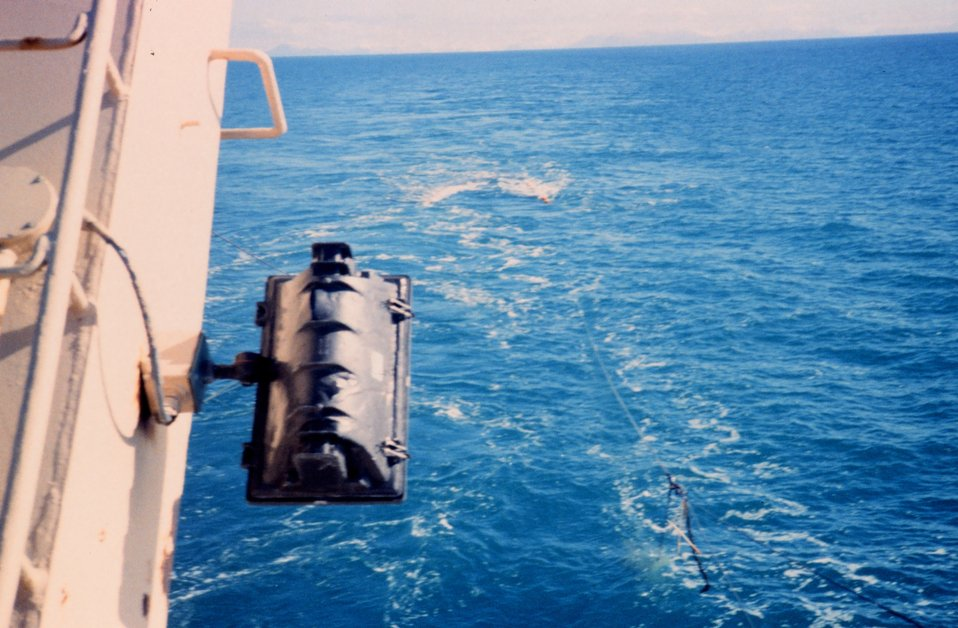 Photo # 4 - Streaming net during  trawling operations.  Just prior to 'shooting the doors' and pulling yellow floats under water.