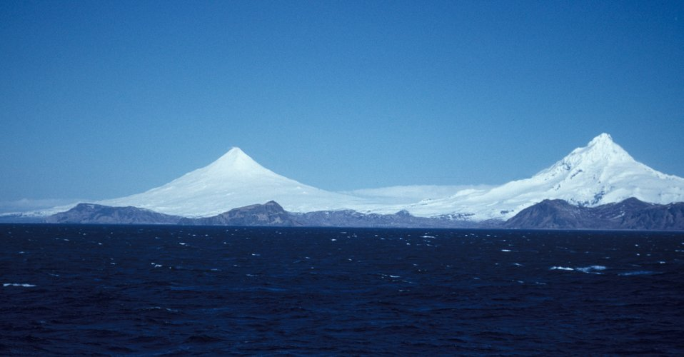 Magnificent view of Shishaldin and Isanotski volcanoes from offshore.