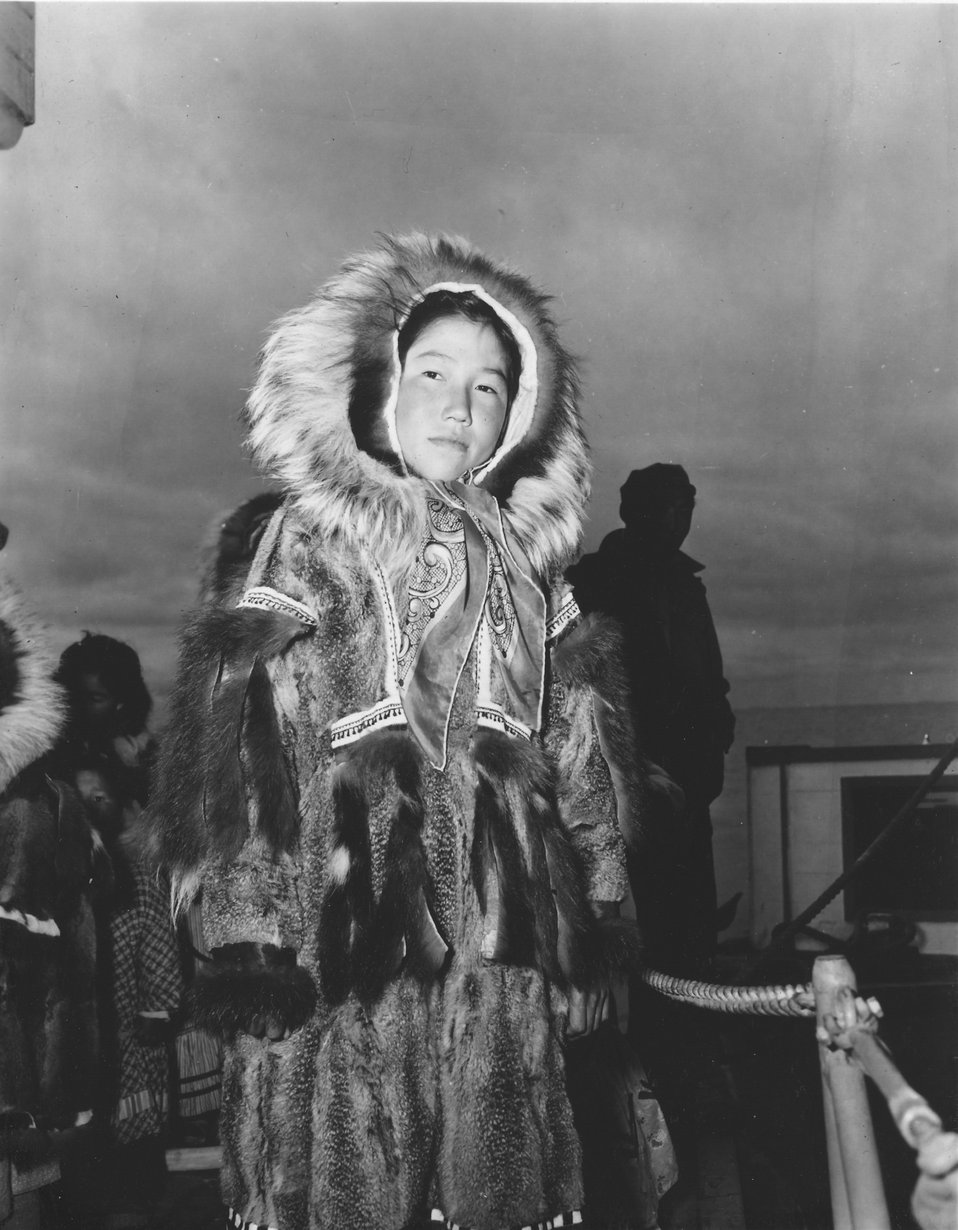 Eskimo girl visiting the C&GS ship EXPLORER, probably at St. Paul Island.