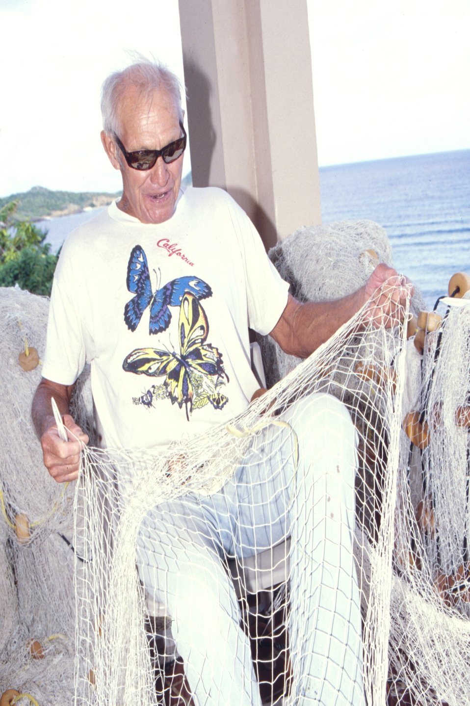 Joe LaPlace mending a net at St. Thomas, U.S. Virgin Islands.