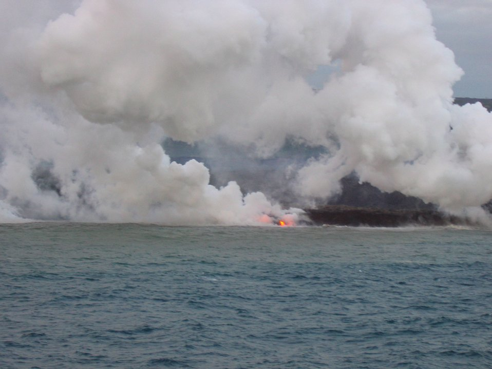 Lava flow entering the sea on SE coast of Hawaii.